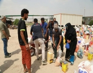 Dary Human Organization distributes 130 food baskets to Anbar displaced people